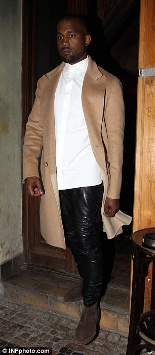 Small change: The Bound 2 rapper wore the same brown suede boots with leather tracksuit pants and tan overcoat that he had worn during the day but added a crisp white shirt