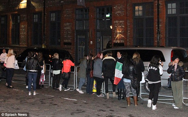 Waiting in line: Fans queued up in order to catch a glimpse of their idols