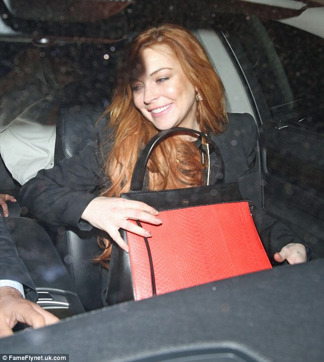 Security bag: Lindsay held on to her red and black handbag