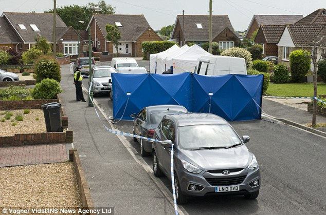 Investigation: A police tent and screens cover the scene where Ms Li's body was found in Bournemouth