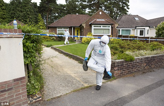 Property: A member of the investigation team outside the home of Legris and Ms Li in Bournemouth