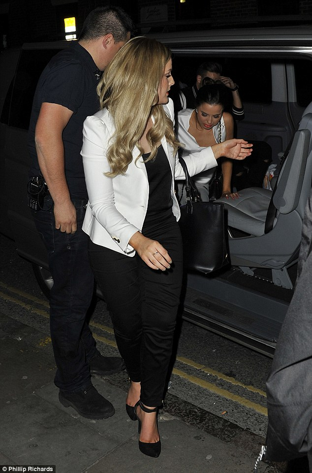 Ladies first: The star, who had earlier been seen heading back to his hotel with Louis, looked in a sombre mood as he got out of a taxi after doing the gentlemanly thing and letting his sibling's female pals go first