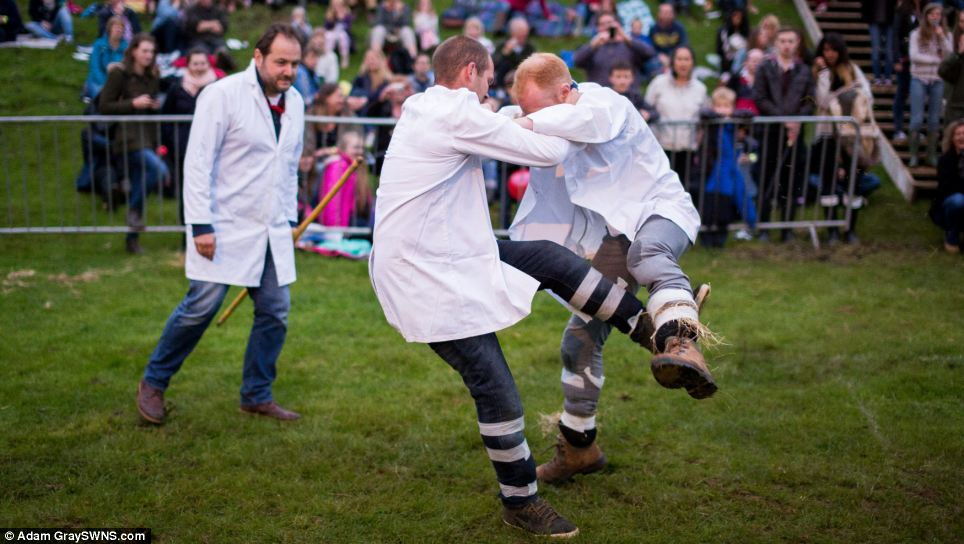 These competitors take part in shin kicking, one of the most eagerly anticipated events at the Cotswold Olimpicks