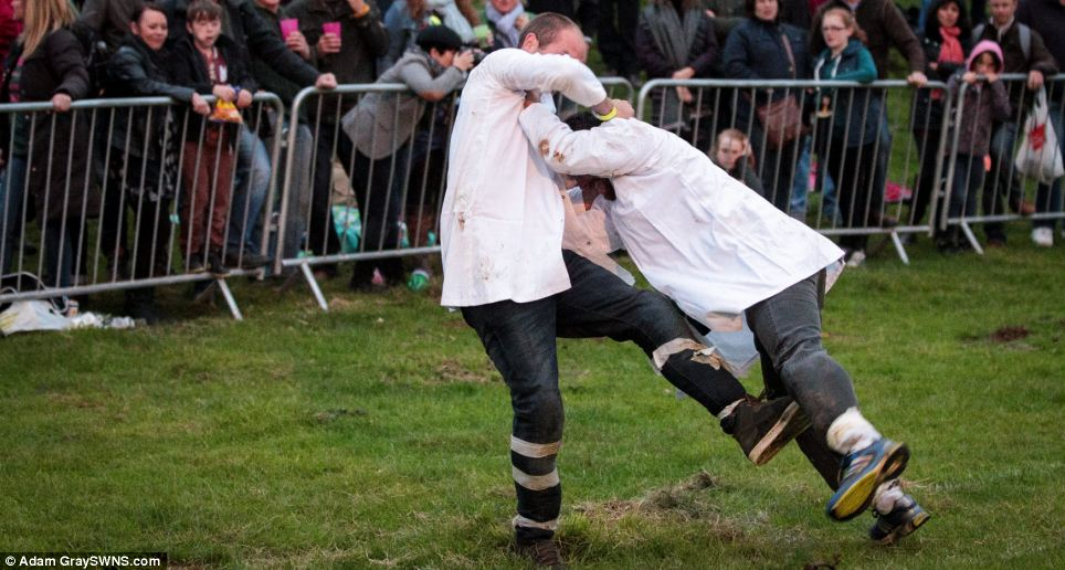 The competitor on the left almost makes his opponent fall to the floor as they battle it out in the hugely popular event