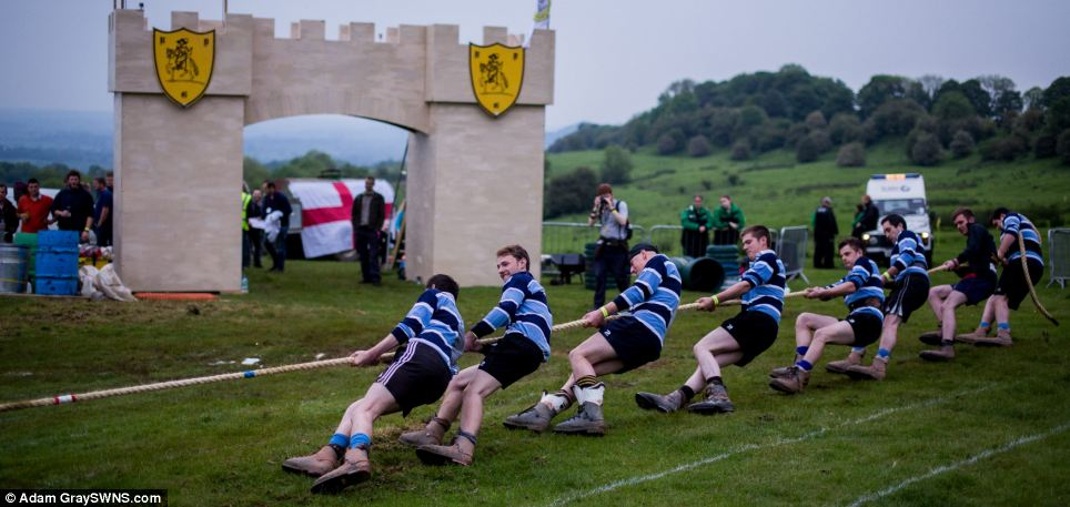 As night falls, the tug of war begins. The event is one of the medieval sports that still make up the Cotswold Olimpicks