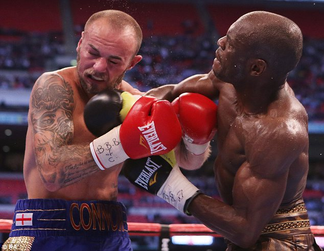 Face off: Kevin Mitchell (left) gets in close against Ghislain Maduma in their lightweight bout