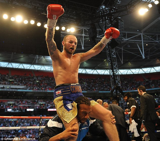 Up for it: Kevin Mitchell celebrates beating Ghislain Maduma at Wembley