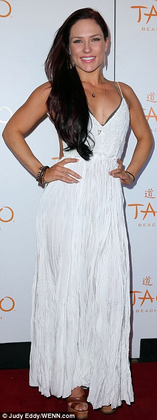 Hello back there, too! Shana Burgess looked gorgeous in a white maxi-dress that featured a cut-out back