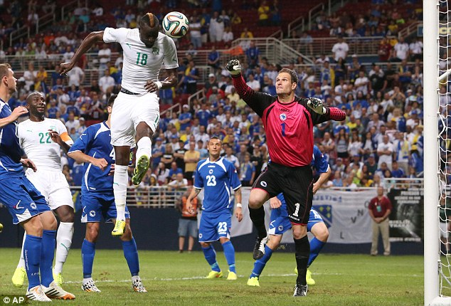 Missed out: Lacina Traore, pictured against Bosnia, has been left out of Ivory Coast's World Cup squad