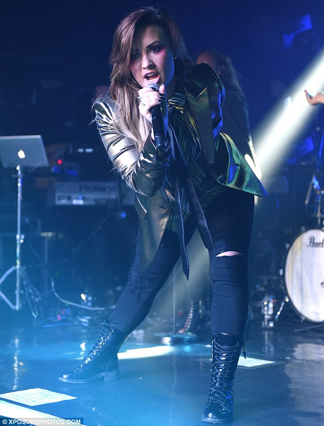 Rocker chick: Demi Lovato ended her Neon Lights tour with a bang, going for an androgynous look in a metallic blazer with a black tie
