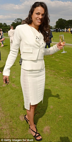 Classic: Michelle wore a white fitted dress with a matching cropped jacket to the Polo