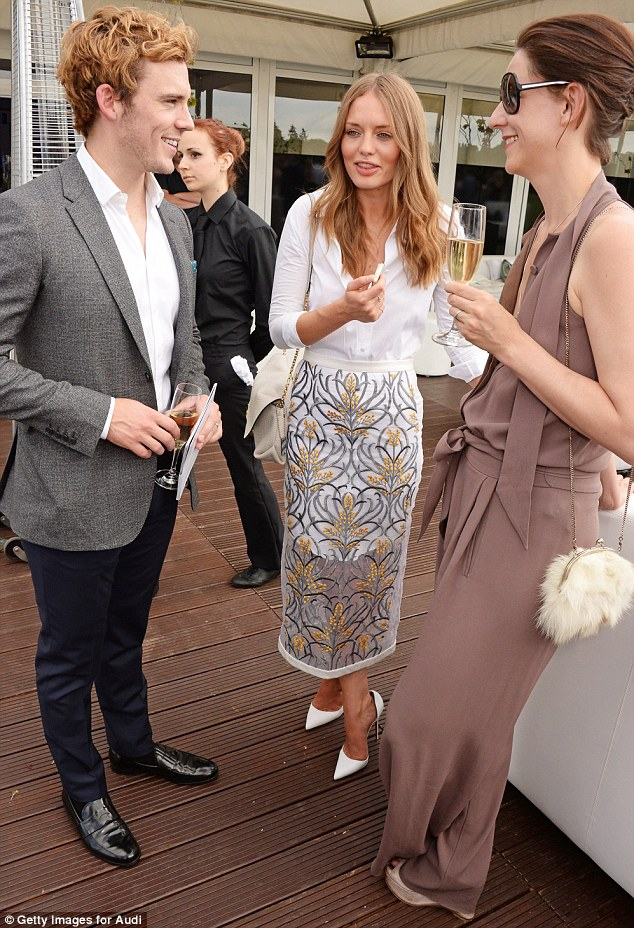 Socialising: Sam and Laura chat to Maria over a glass of champagne