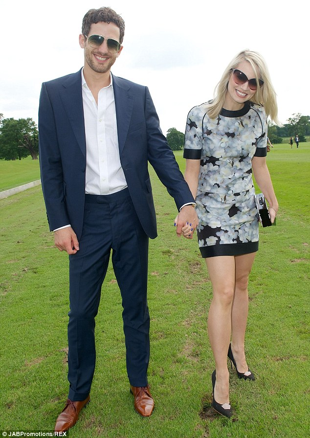 Divot stamping: Kimberly Wyatt and her husband Max Rogers help replace the mounds of earththat are torn up by the horses' hooves