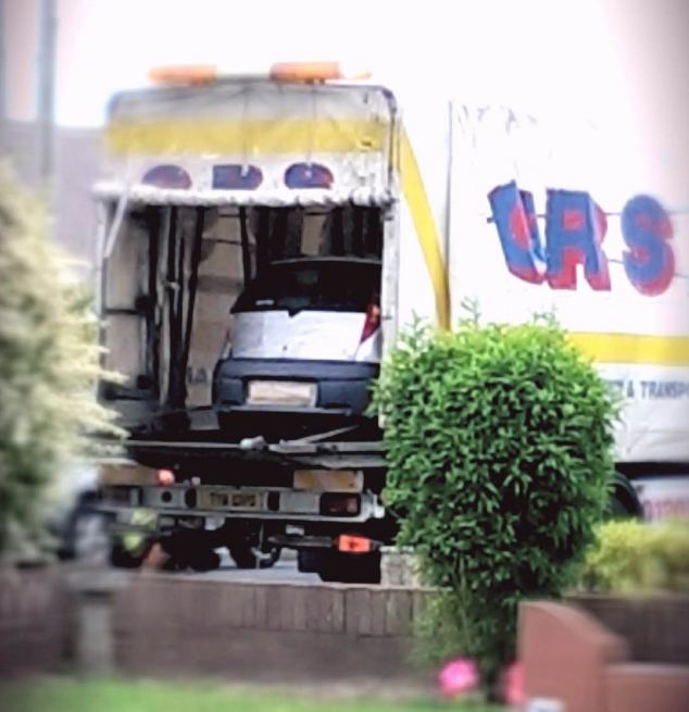 Evidence: The car in which the body of missing nurse Rui Li was found, being taken away by police