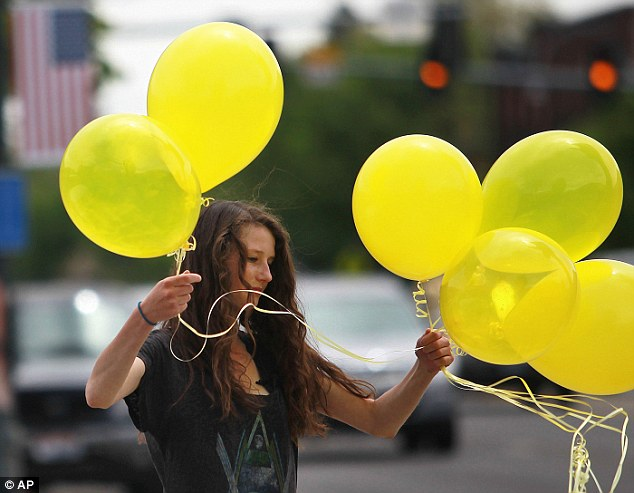Rachel Malone, 17, ties balloons along Main Street in Hailey in preparation for Bergdahl's homecoming