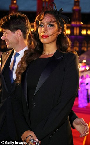 The veiled lady X Factor winner Leona wore a striking black ensemble for her night out at the annual event