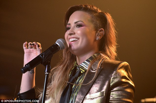Living her dream: Demi glowed with joy as she performed