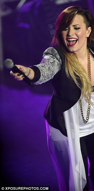 Reaching out: Demi has said she wants to be a role model now for young people and to help them
