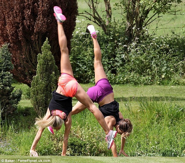 In tune: Luisa and her trainer were in step as they did a cartwheel