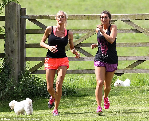 On the run:  Luisa was seen jogging through the field alongside her trainer