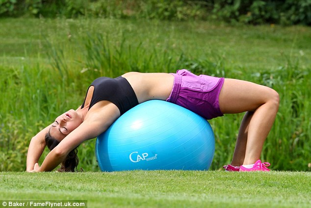 Taking a moment or two: Luisa looked to be enjoying on of the stretches on a fitness ball