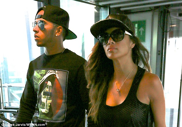 Ready for the sun: Both Lewis and Nicole kept their sunglasses on, which the former teamed with a sweatshirt with arty motif