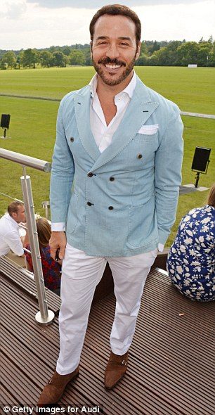 Dapper: German model Johannes Huebl, who is engaged to Olivia Palermo, wears a navy blazer, cream chinos and a denim shirt, while Jeremy Piven wore a double breasted denim blazer, white trousers and a shirt to match