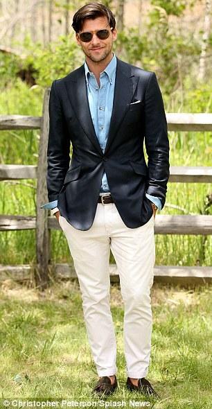 Dapper: German model Johannes Huebl, who is engaged to Olivia Palermo, wears a navy blazer, cream chinos and adenim shirt