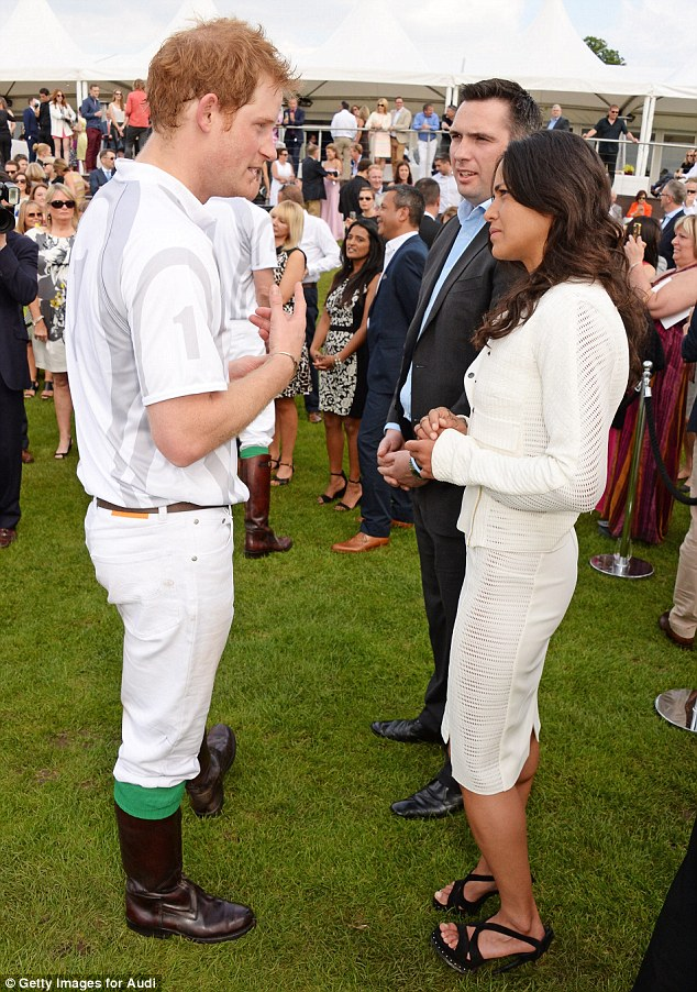 Royal company: At the match Michelle got the chance to chat to Prince Harry