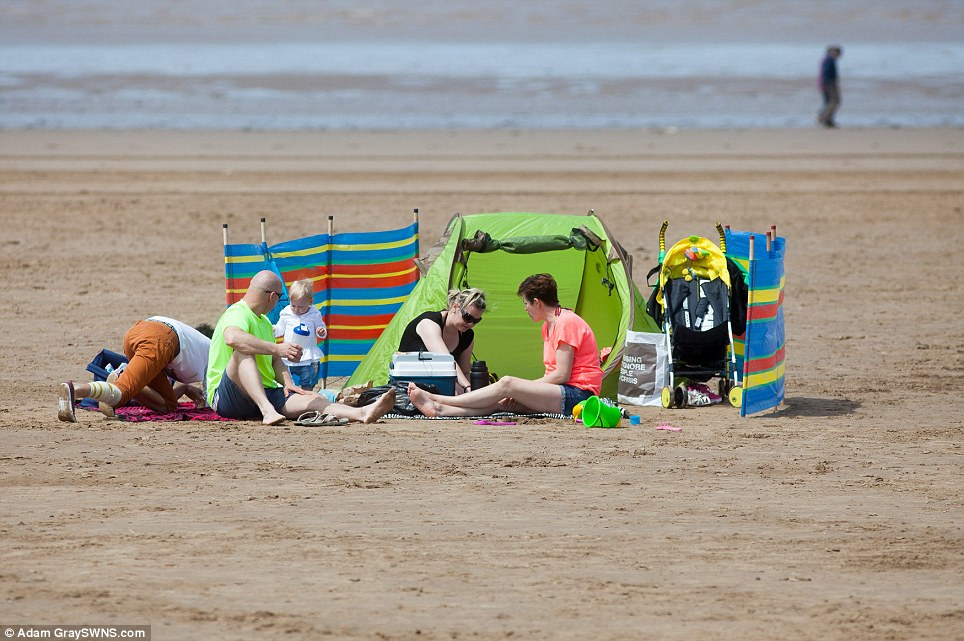 On the beach: Another view of people making the most of the hot weather on the last day of half term in Weston-super-Mare