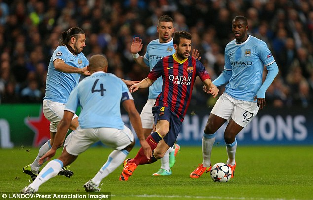 Crowded out: Fabregas, pictured playing against Man City last season, looks set to leave the Nou Camp