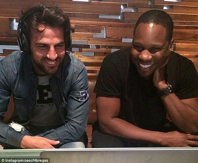 All smiles: Fabregas was in England this weekend to film a 'Beats by Dre' advert