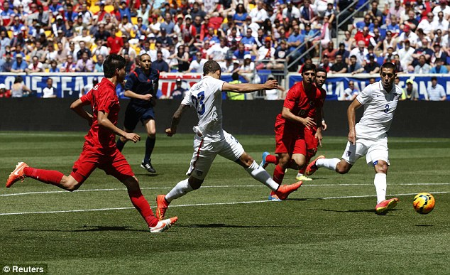 Strike: The U.S. team (in white) in action against Turkey on Sunday. Turkey's coach praised their performance