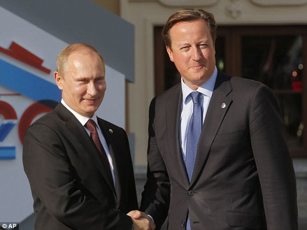 Russia's President Vladimir Putin, left, shakes hands with British Prime Minister David Cameron during arrivals for the G-20 summit at the Konstantin Palace in St. Petersburg, Russia on Thursday, Sept. 5, 2013. The threat of missiles over the Mediterranean is weighing on world leaders meeting on the shores of the Baltic this week, and eclipsing economic battles that usually dominate when the G-20 world economies meet. (AP Photo/Dmitry Lovetsky)