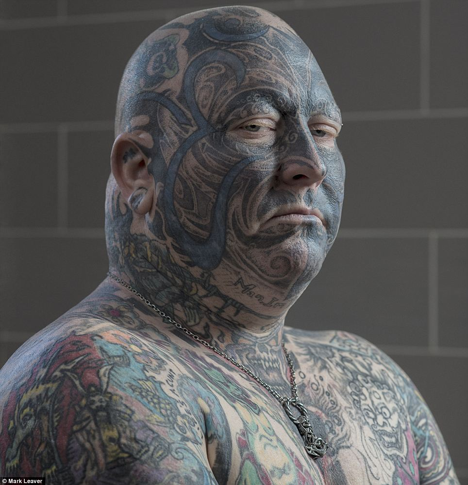 Intimate side: A photographer has created a captivating series of portraits dedicated to showing the more intimate, relatable side of men and women with tattooed faces. Here, 50-year-old Rusty Walters shows off his ink