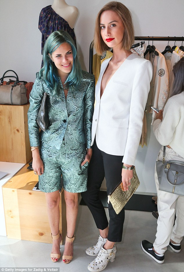 Lean, green machine: Tallulah posed next to her Clothing Coven blog partner Mallory Llewellyn at the event