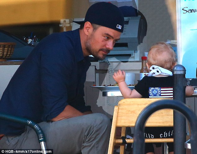 What's he saying? Actor Josh Duhamel listened closely to his six-month son Axl during their boys-only breakfast in LA Sunday