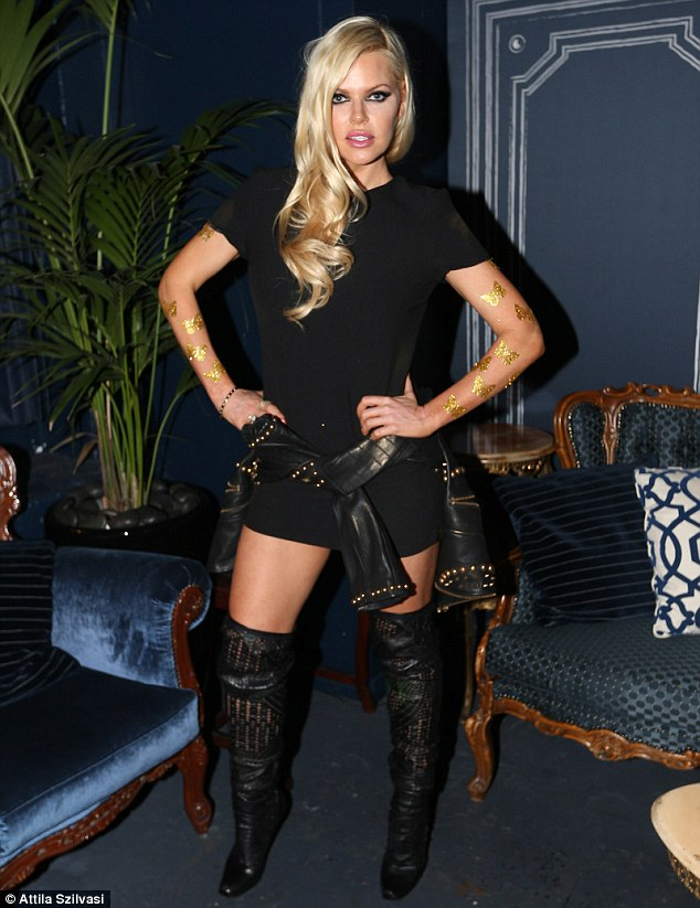 These boots were made for? Sophie looked fierce as she pulled out all the stops to get noticed in her raunchy night time look