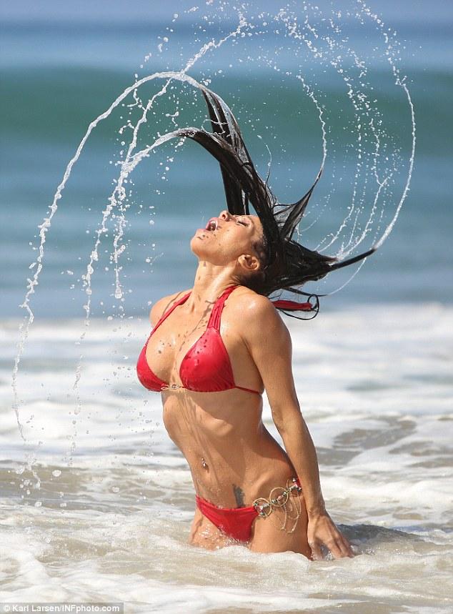 Splashing around: Carlton showed off her incredibly trim and toned body on Sunday in Malibu