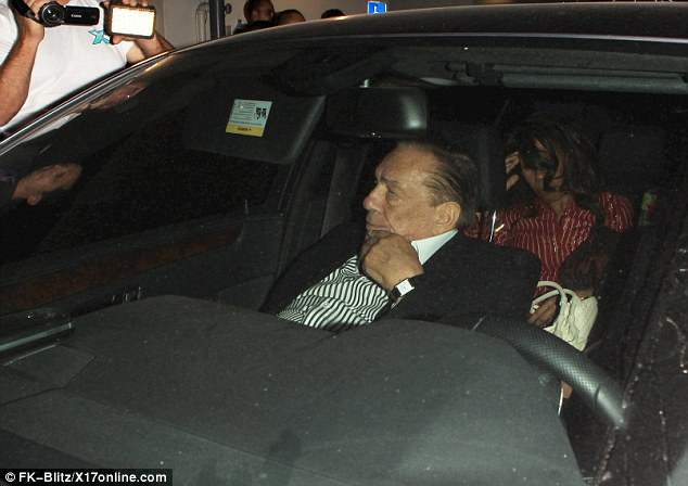 Famous: Media and curious passers by filmed Sterling as he was driven away