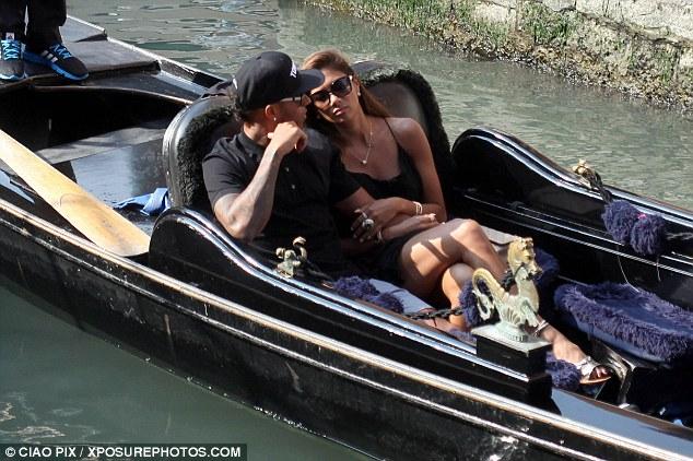All aboard: Nicole Scherzinger and her Formula 1 beau Lewis Hamilton enjoy a gondola ride in Venice, Italy