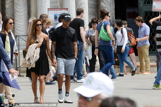 Faces in the crowd: Seemingly oblivious to those around them,  the couple seemed lost in their own little world