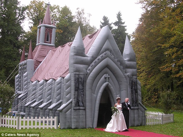 Spacious: Xtreme Inflatables say the church can fit about 60 guests inside - enough for a small wedding