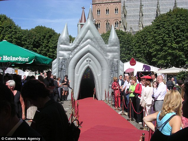 Anticipation: Guests gather in front of the inflatable church as a wedding takes place inside
