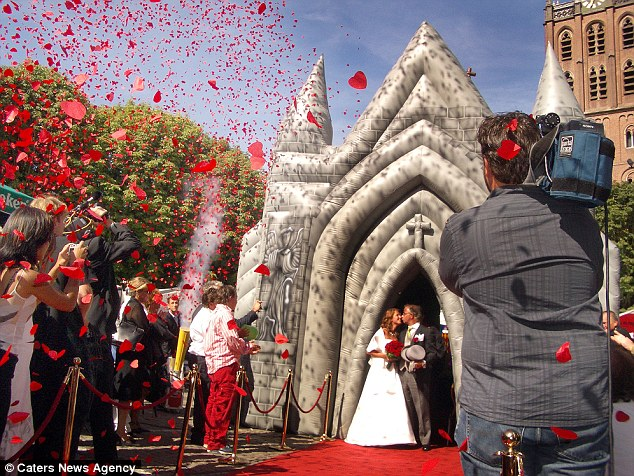 Love, honour and inflate: Standing at 12 feet tall and 12 feet long, there is enough space inside the inflatable church for up to 60 guests - helping to complete that wedding day feel