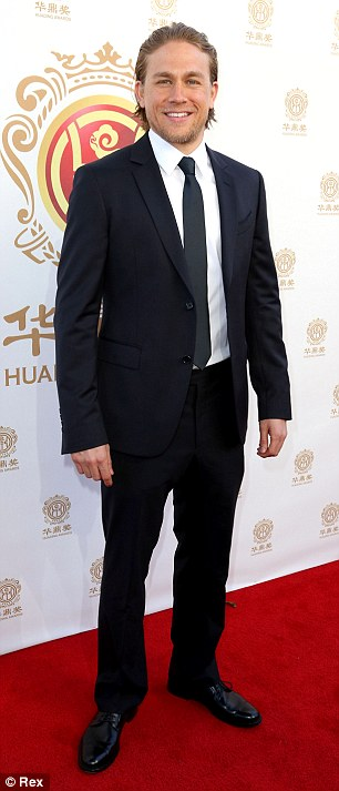 Dapper duo: Orlando Bloom and Charlie Hunnam ramped up the eye candy on the red carpet at the Huading Film Awards in Hollywood on Sunday
