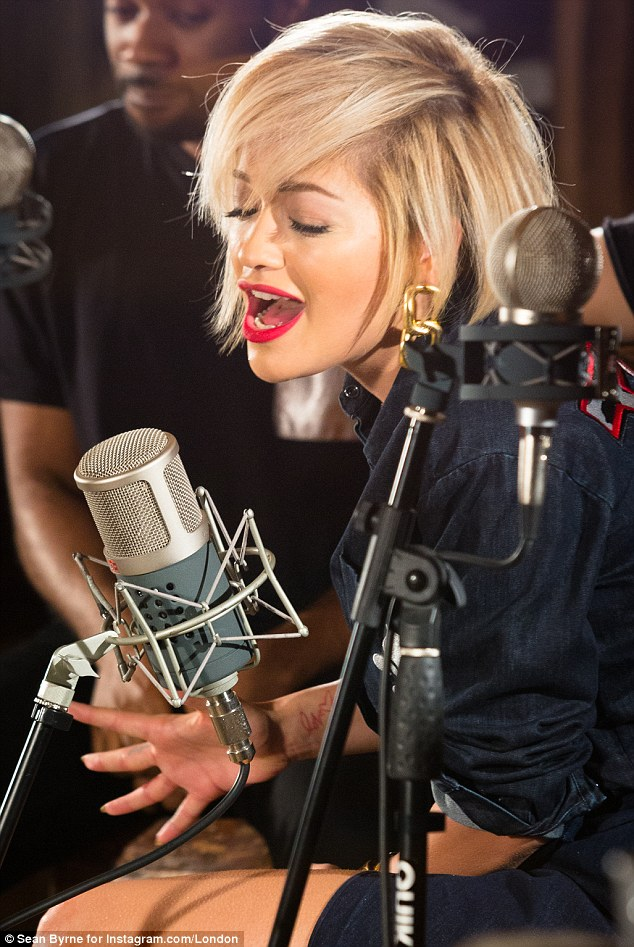The New Classic: In a set of exclusive pictures taken by Instagram/London, the singer can be seen sitting behind a mic with her band during the session