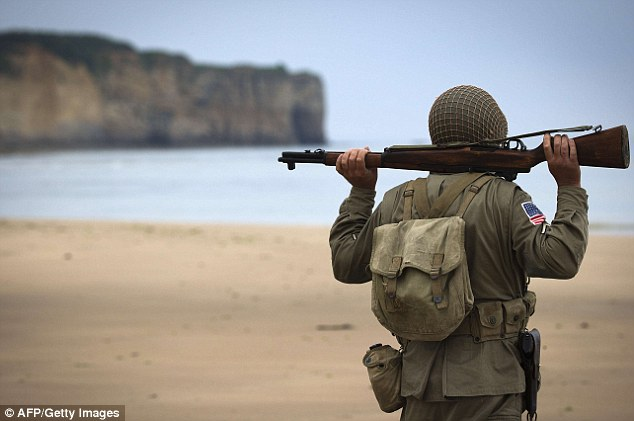 A man, wearing a uniform of the US WWII soldiers stands on the Vierville-sur-Mer beach, one of the D-Day landing beaches in Normandy, a few days before the 70th anniversary of the D-Day landings