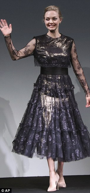 Frills: The dress featured a full lace skirt and sheer sleeves which were embroidered