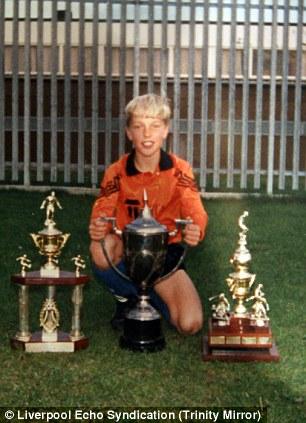 Trophy life: Rickie Lambert, aged nine with plenty of silverware at Millbrook Primary School in Kirby